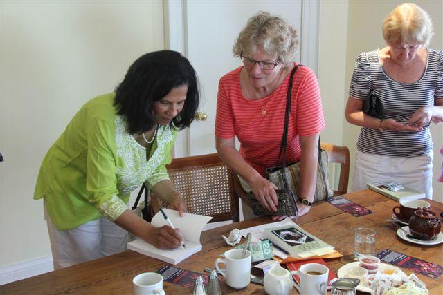 Cynthia signing book spirit of the hills