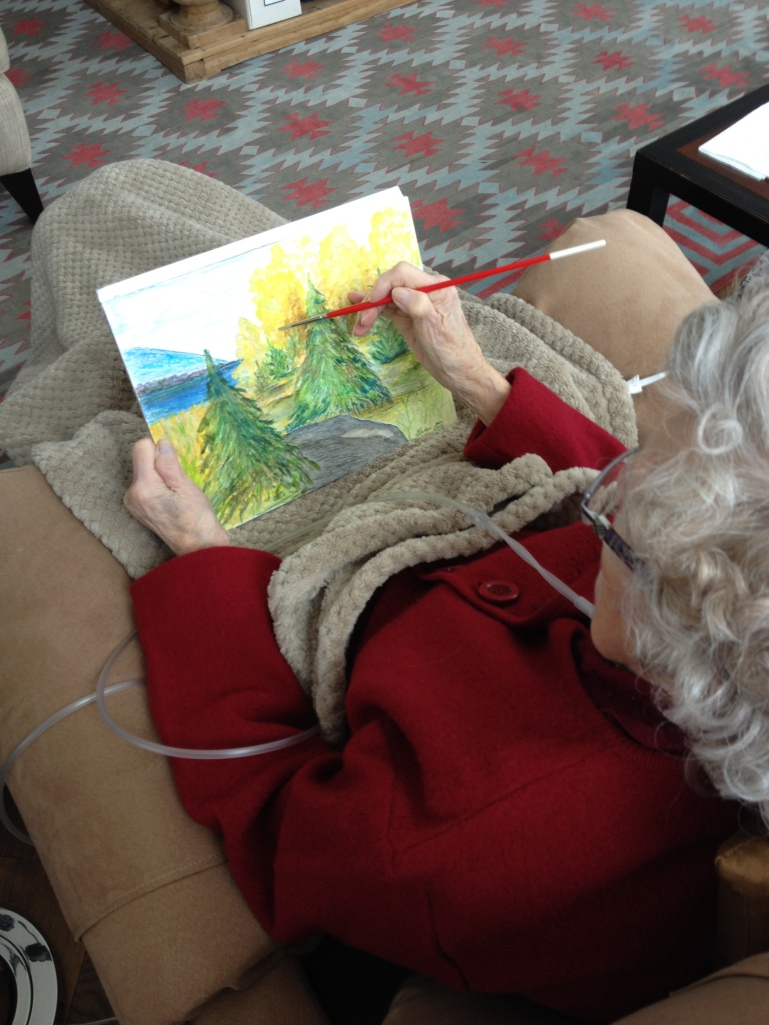 Gladys creates one of her last paintings