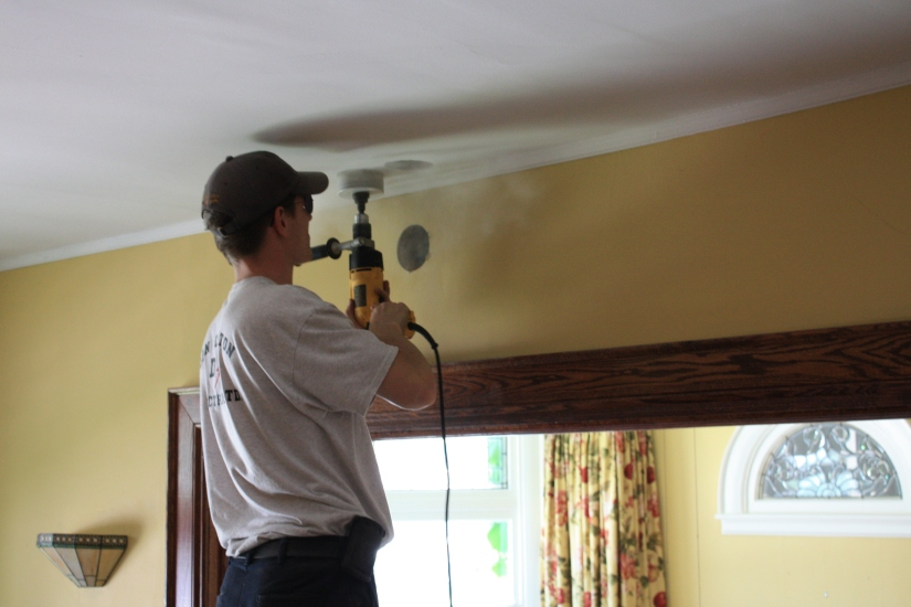 Blog Photo - electrician working on ceiling
