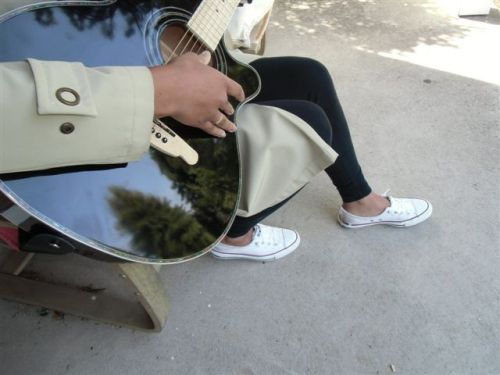 Blog Photo - Guitar playing with sky reflected