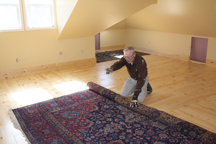 Blog Photo - John unrolls carpet