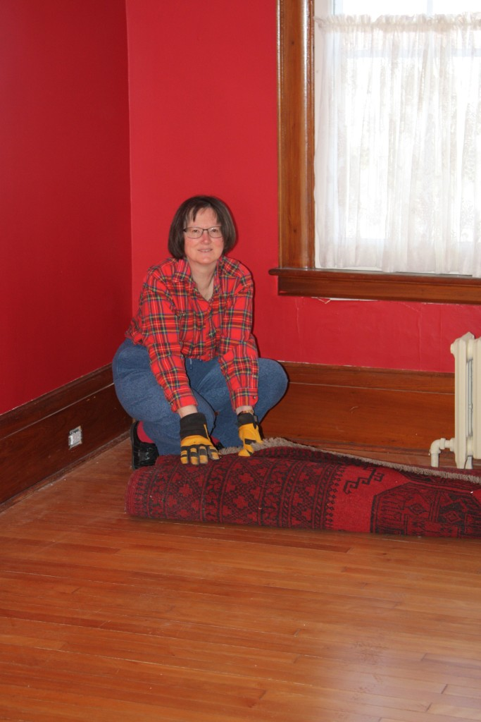 Blog Photo - John's Hosue Ann unrolls carpet