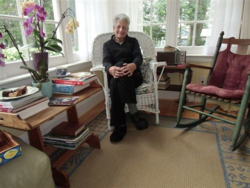 Blog Photo - Artist Sandra in Sunroom wicker chair