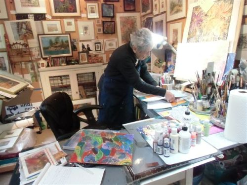 Blog Photo - Artist Sandra stands at work table