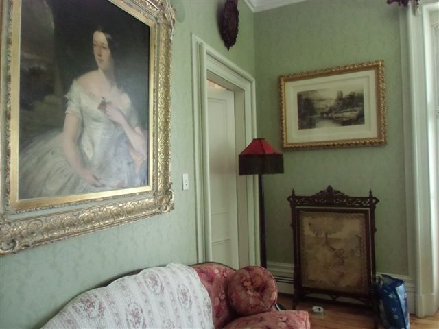 Blog Photo - Ebor House Green Room with portait and walls and furniture
