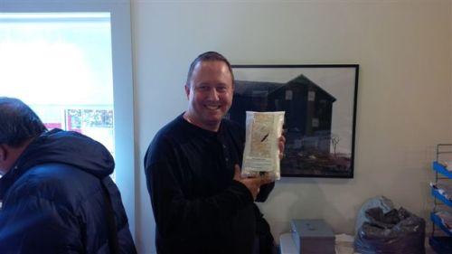 Blog Photo - Famers market Corey holds strudel