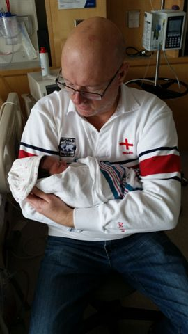 Blog Photo - Paul with first grandchild 2