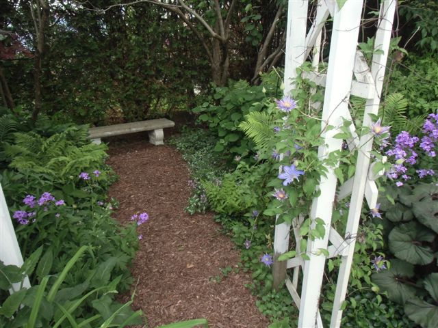 Mama's Garden Path and Arbor side