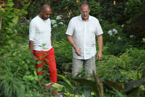 Bob, right, shows a visitor the garden