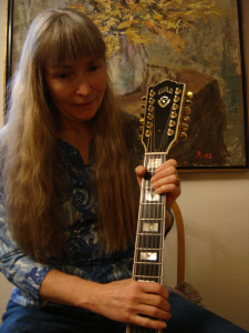 Blog Photo Lavinia playing guitar