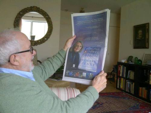 louise-penny-michael-looks-at-nyt-ad-for-louises-book