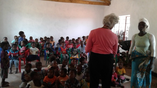 Blog Photo - Kamala-Jean and teacher at front of class
