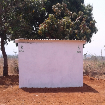 blog-photo-kamala-jean-story-latrines-outside-schoolhouse.jpg