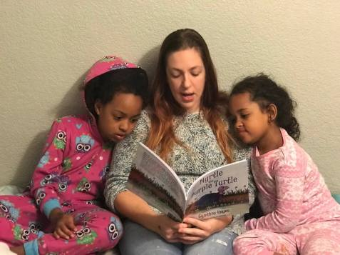 Blog Photo - Myrtle being read to 2 daughters