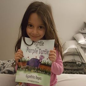 Blog Photo - Myrtle book held by Aggeliki - 6 yrs old - mother Theano takes photo
