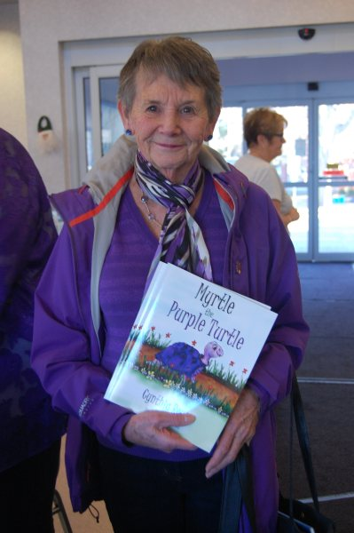 Blog Photo - BoAA Book signing - Purple lady with books