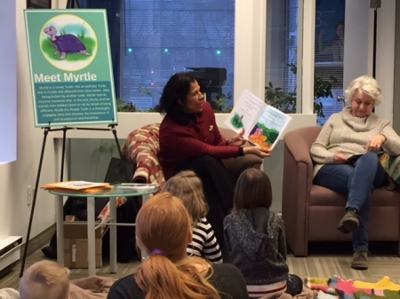 Blog Photo - Cynthia reads book at DUCA storytime