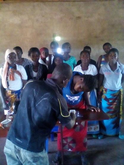 Blog Photo - Kamala-Jean -- Happy demonstrating how the sewing machine works