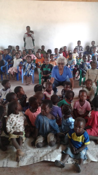 Blog Photo - Kamala-Jean kneels with kids