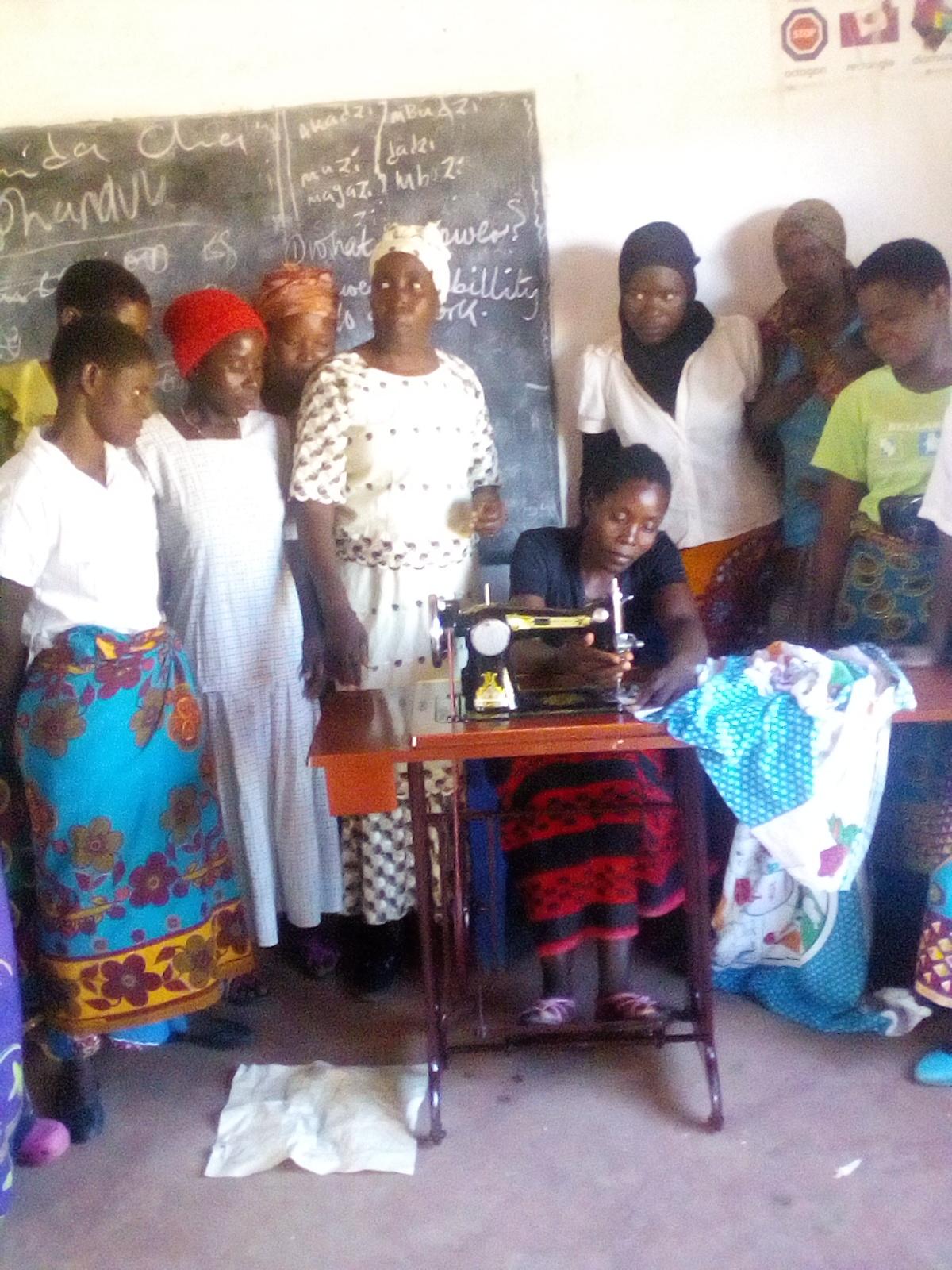 Blog Photo - Kamala-Jean -- Woman sews and others watch2