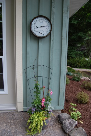 Blog Photo - Carol garden with barometer over flower pot