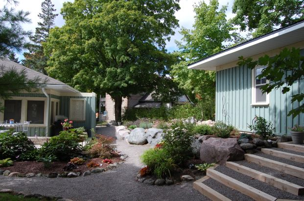 Blog Photo - Wayne's Fountain shows back of house and coach house and rocks