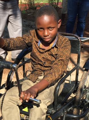 Blog Photo - CanUgan Boy in Transport device