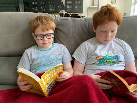 Blog Story - Ciaran and Fiona sons reading